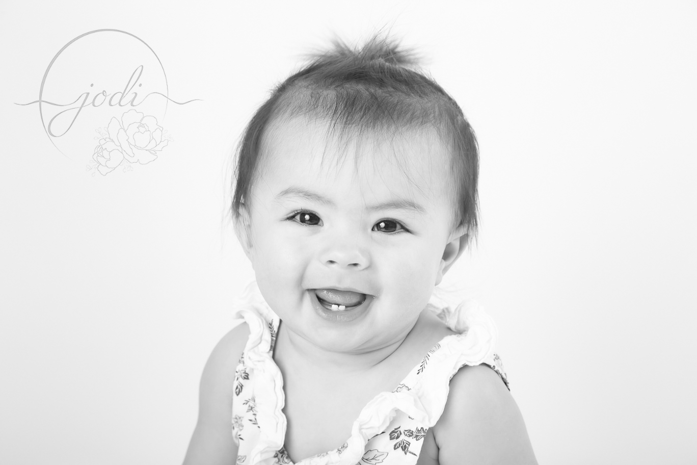 Sharing blog posts of little smiling face by Calgary Photographers